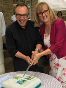 Photo of Dave & Kath cutting cake